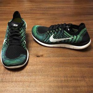 Nike Free 4.0 Flyknit Shoes.